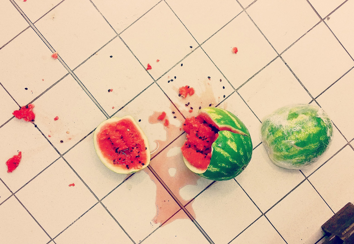 A watermelon has broken after accidentally being dropped on the floor.
