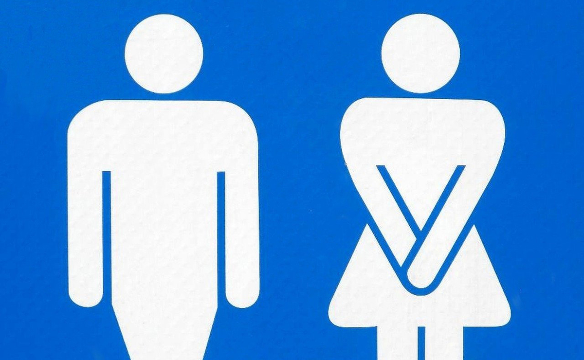 Male and female restroom logos pose like they have to use the restroom.