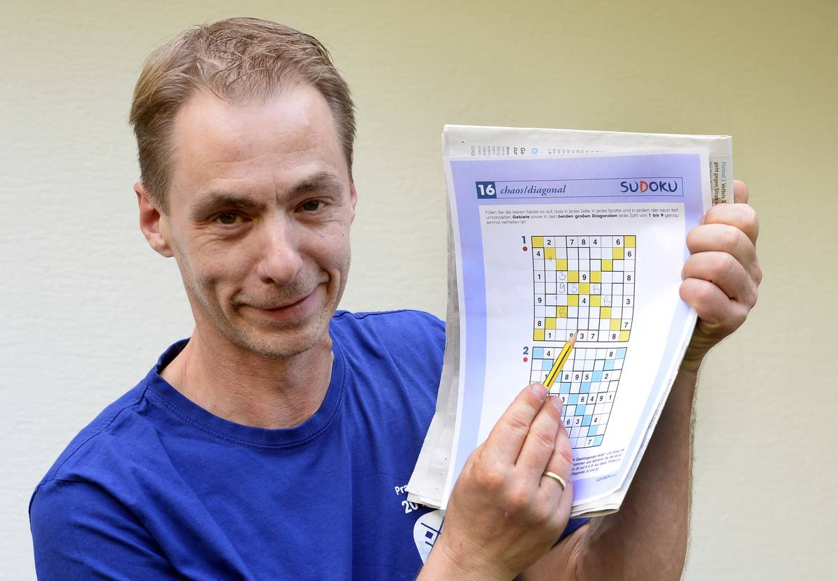 The World Champion of sudoku, Michael Ley, shows off his puzzle.