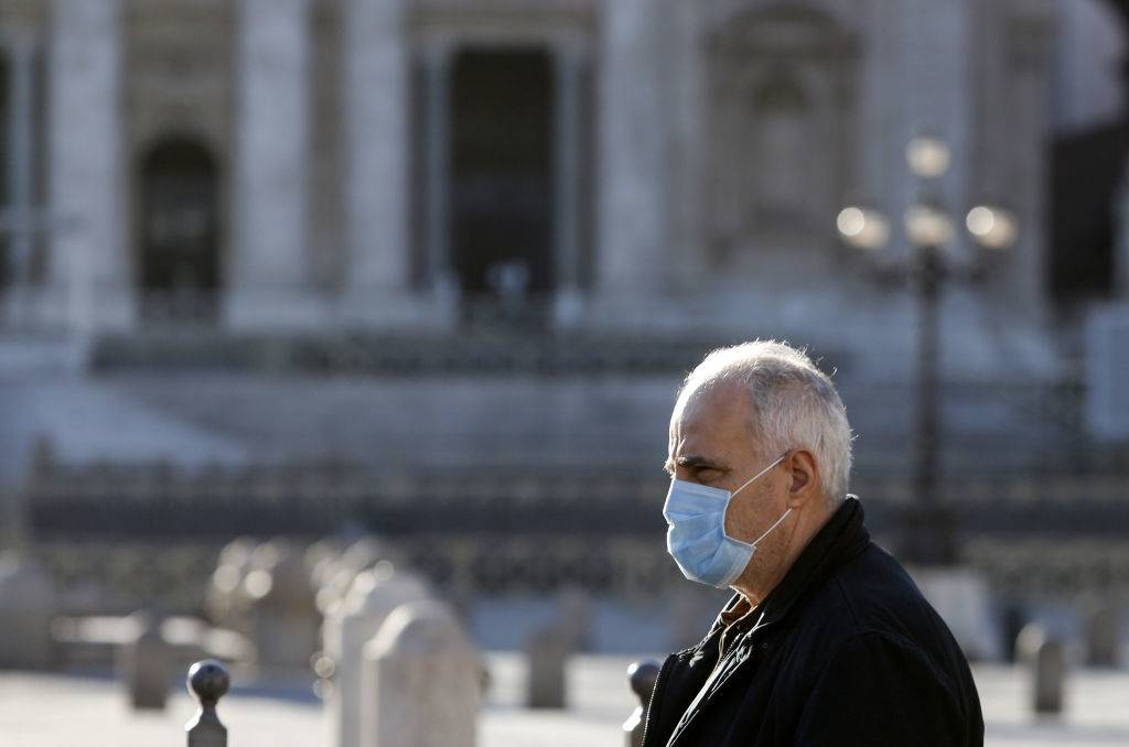 an older gentleman wearing a mask in italy