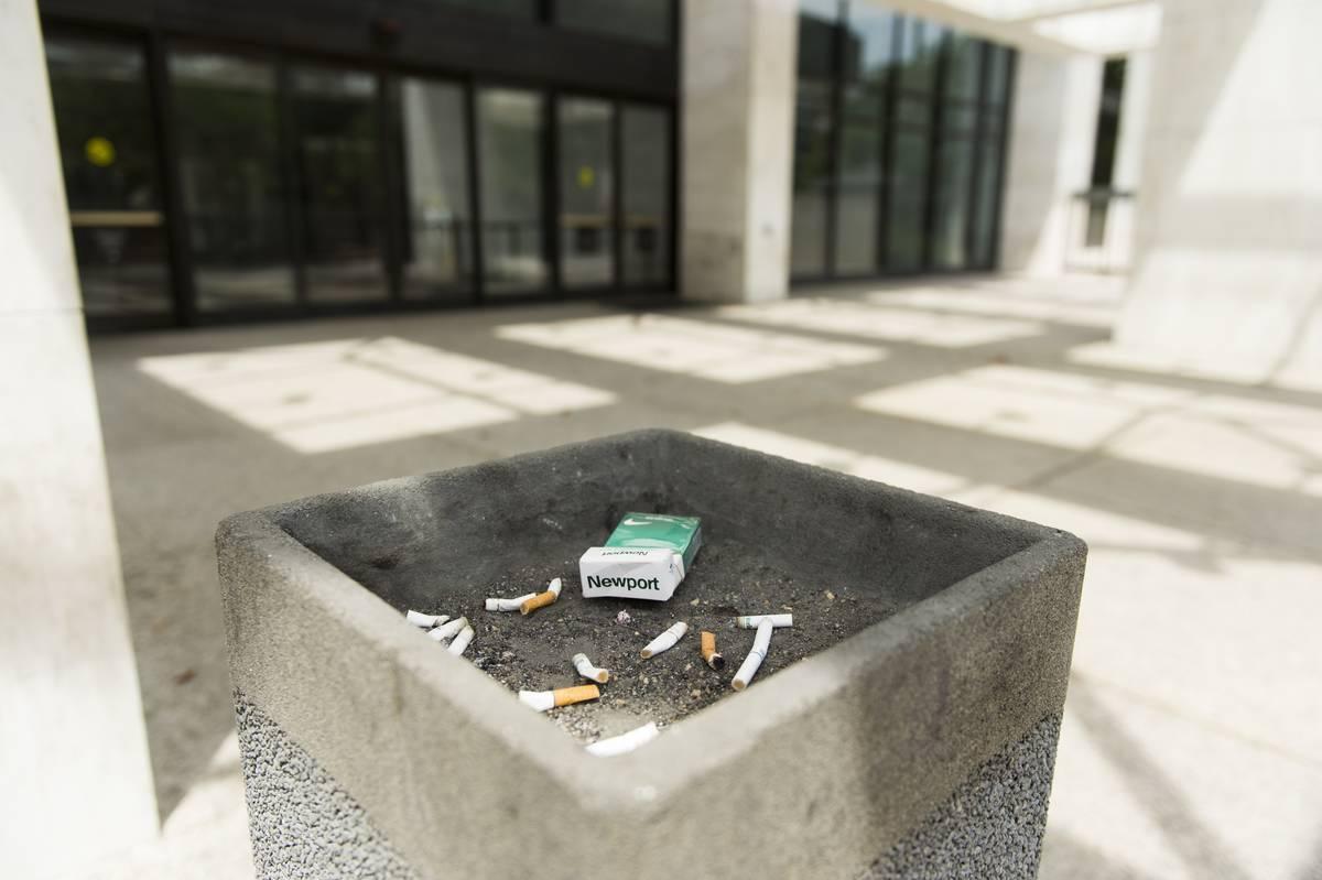 A public ash tray is seen in public.