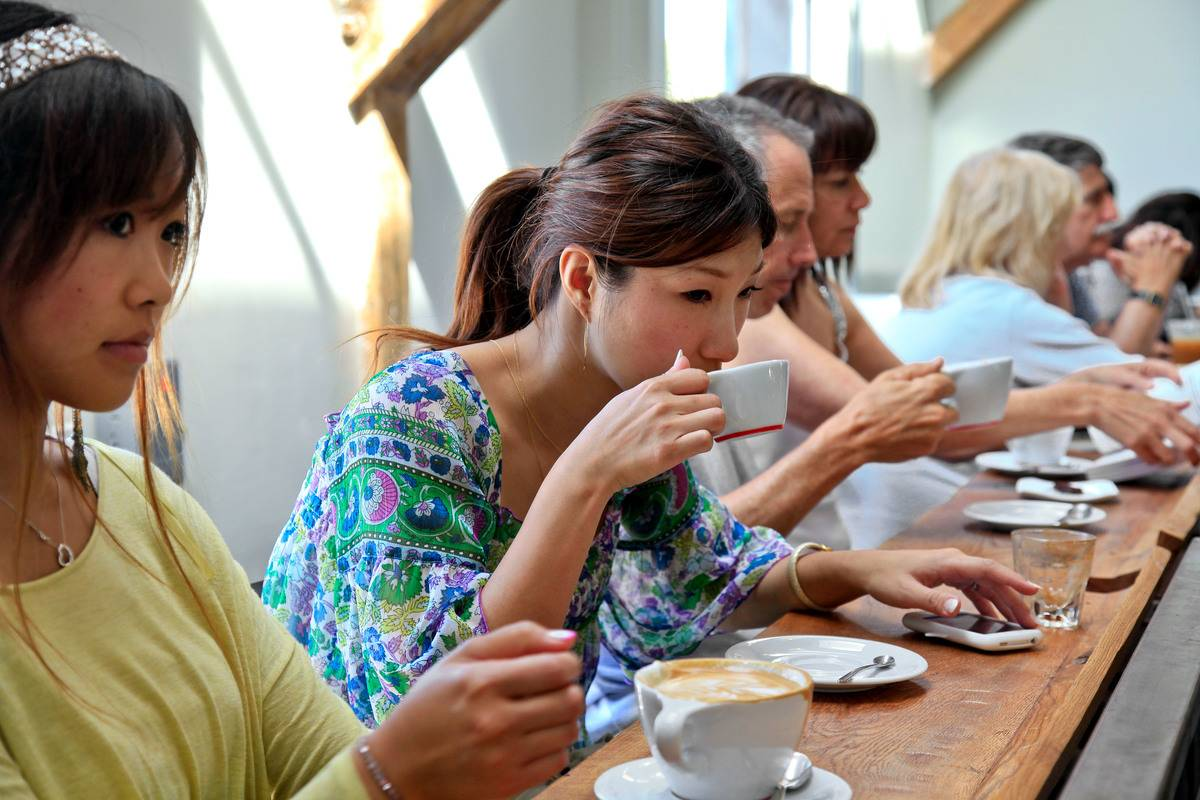 Customers enjoy coffee at a cafe in Venice.
