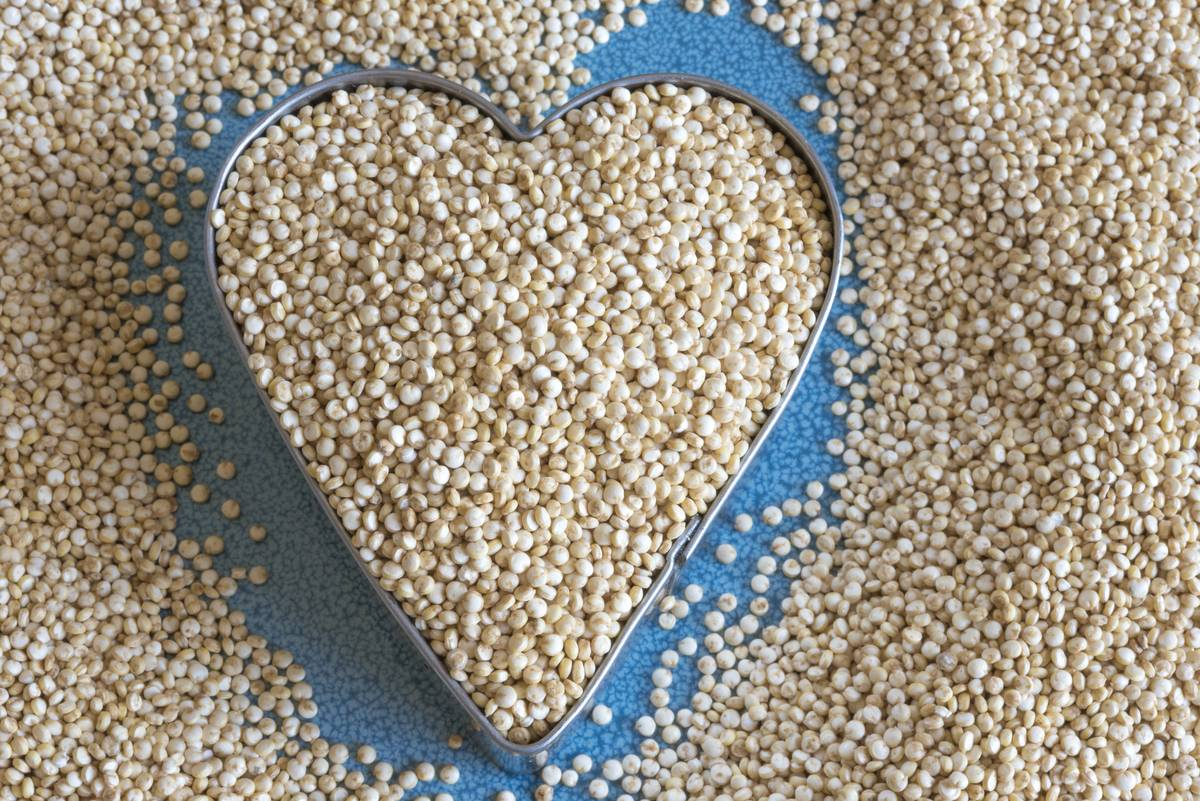 Dried quinoa is inside of a heart-shaped cookie cutter.
