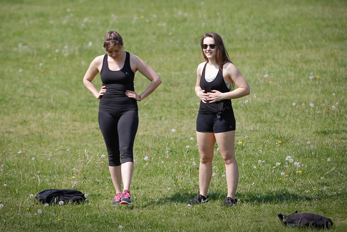 Two women take a break from exercising.
