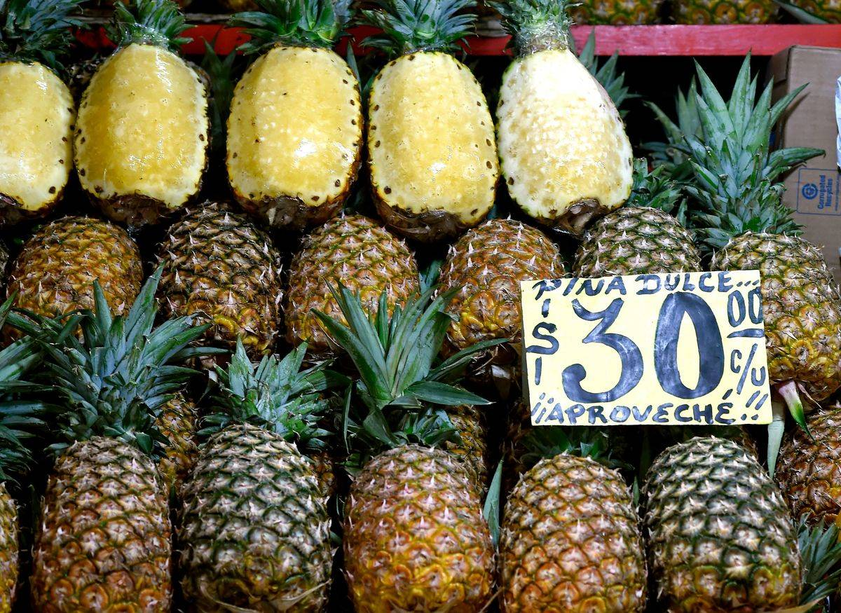 Whole pineapples are on sale at a Mexican market.