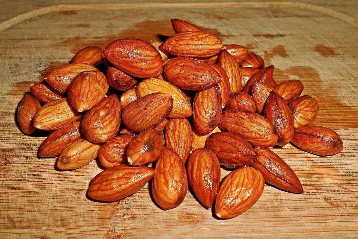 Wash almonds sit on a cutting board.