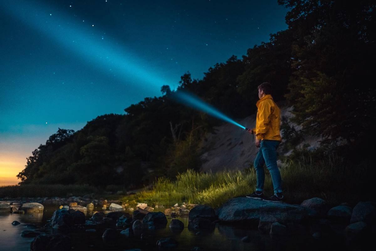man-holding-a-flashlight