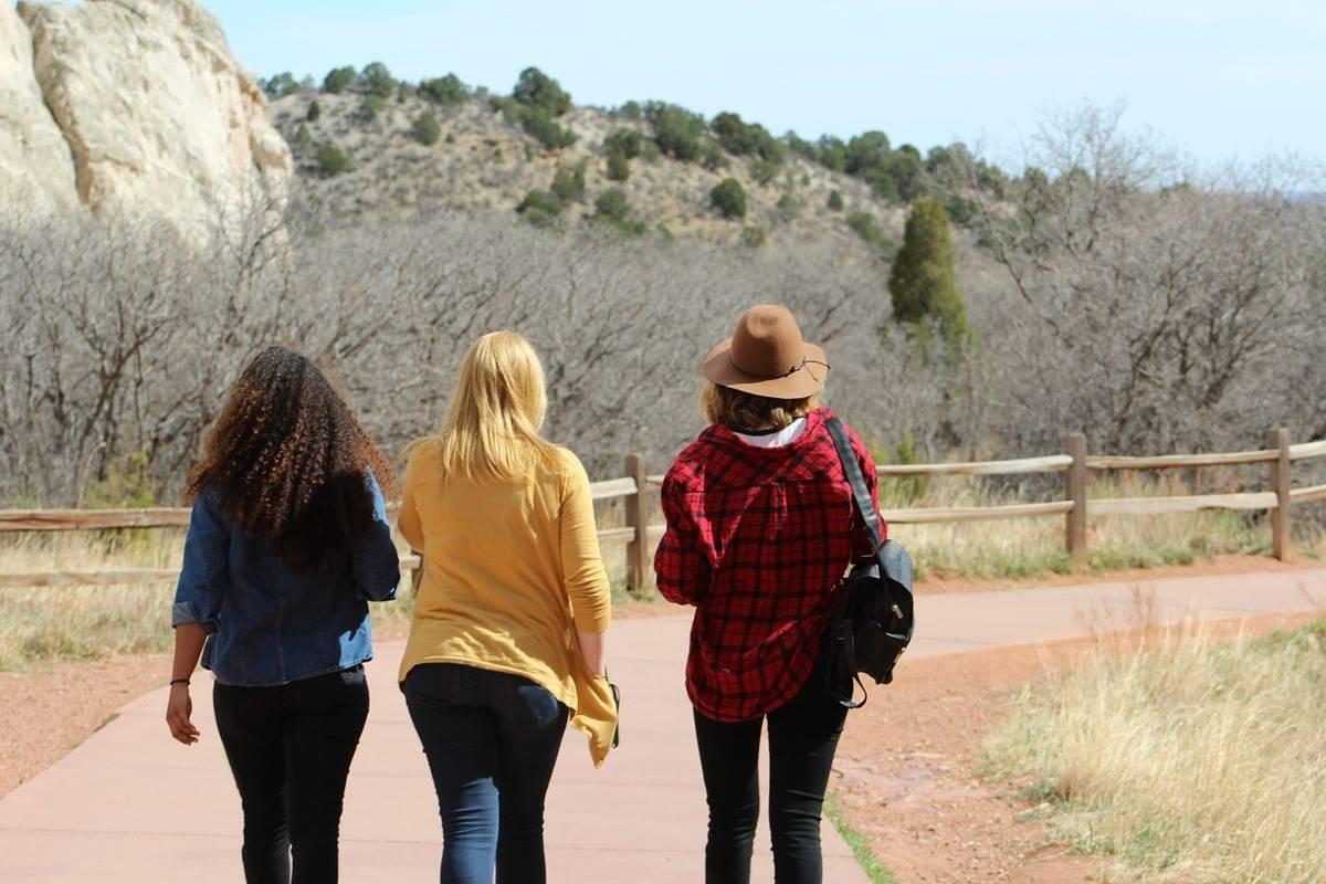 Friends walk outside together.