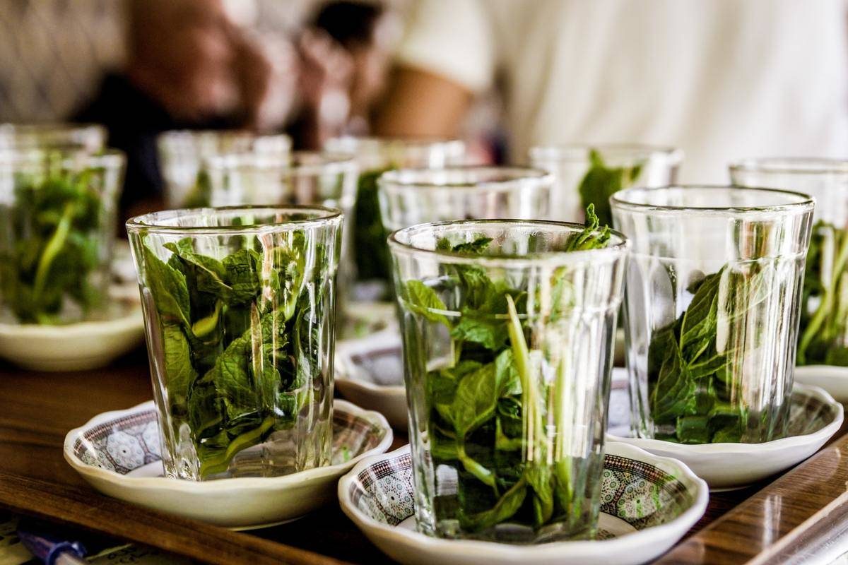 Glasses are filled with peppermint tea.