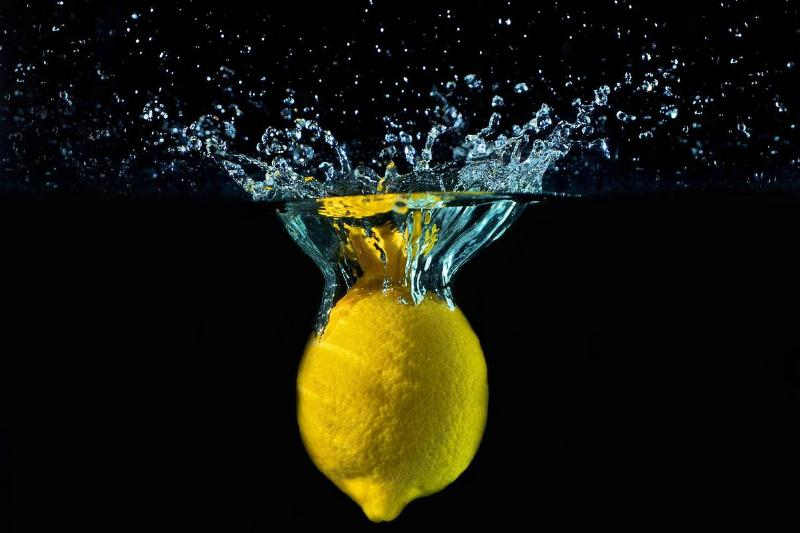 A graphic shows a lemon falling into water.