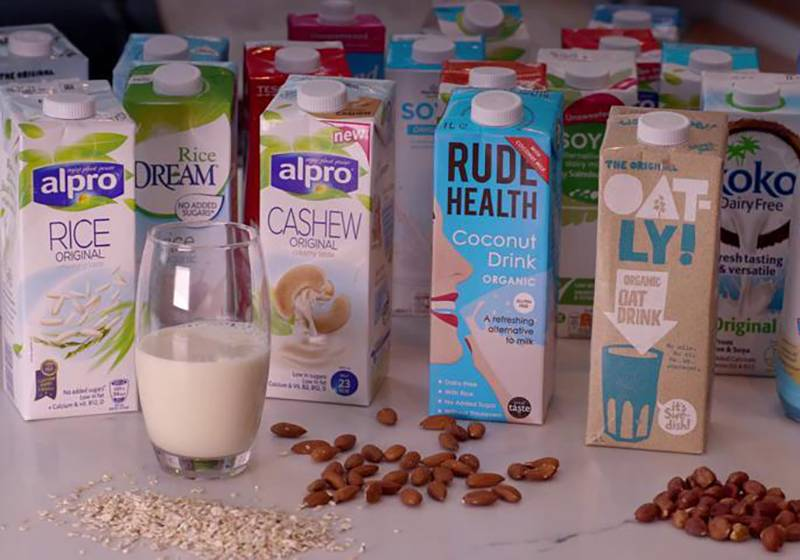 Several different cartons of milk alternatives are seen.