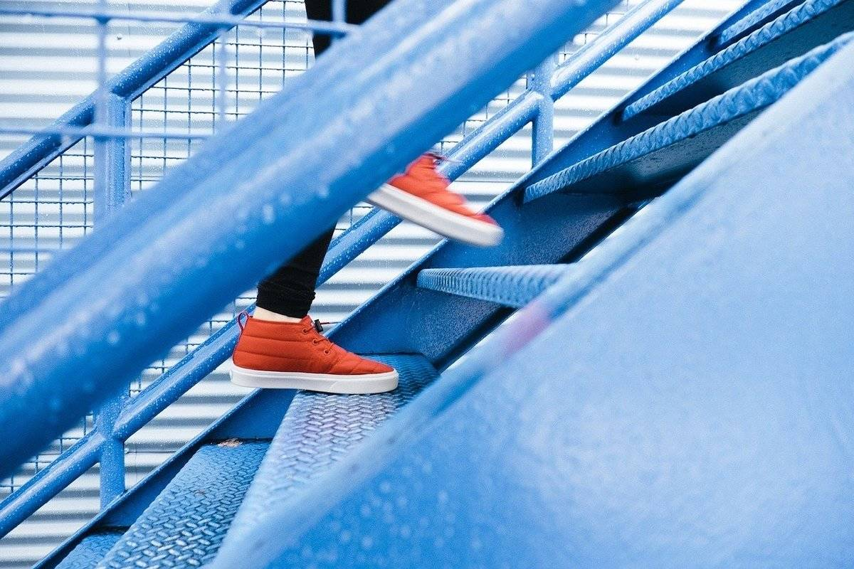 A man climbs stairs.