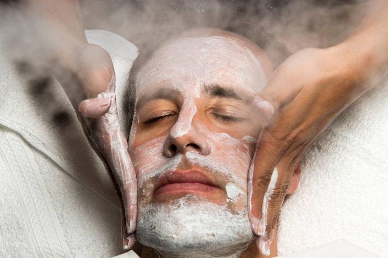 A man receives a steam facial.