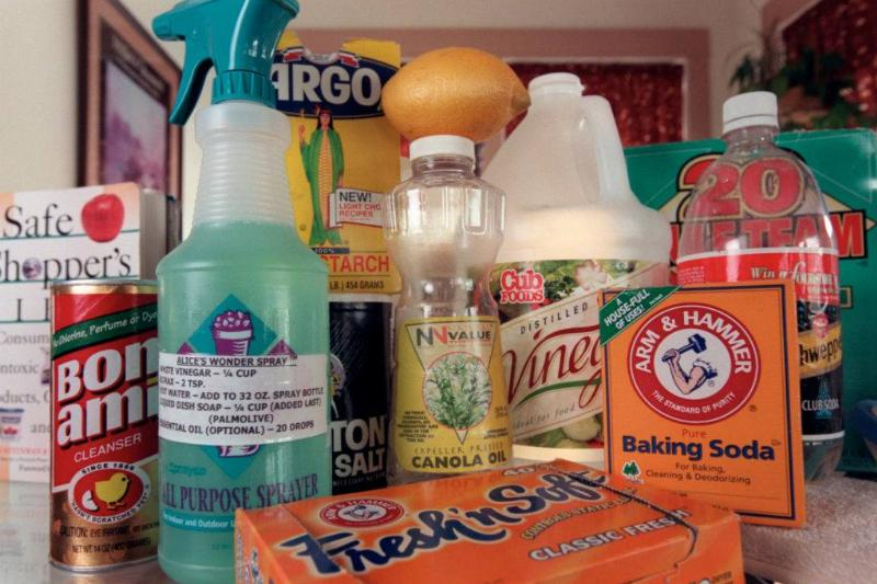 Natural cleaning products sit on a counter.