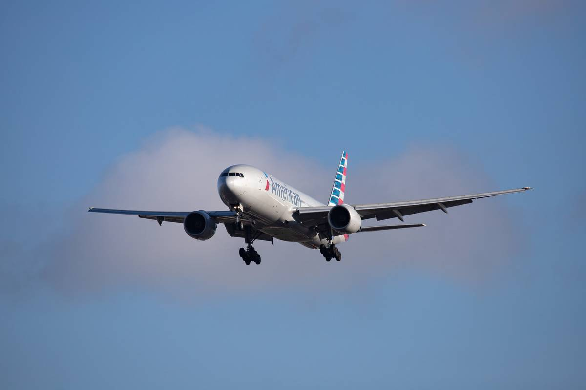 A commercial airplane from American Airlines flies through the sky.