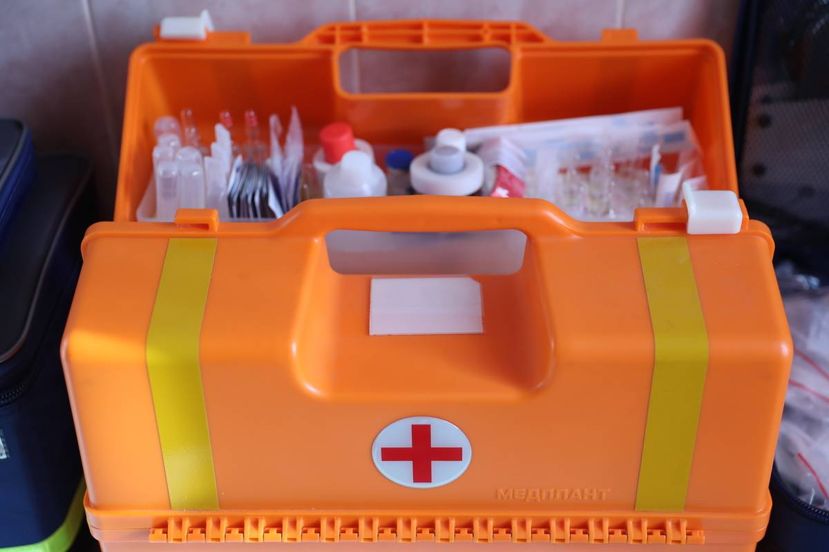 A close-up shows a paramedic's first aid kit.