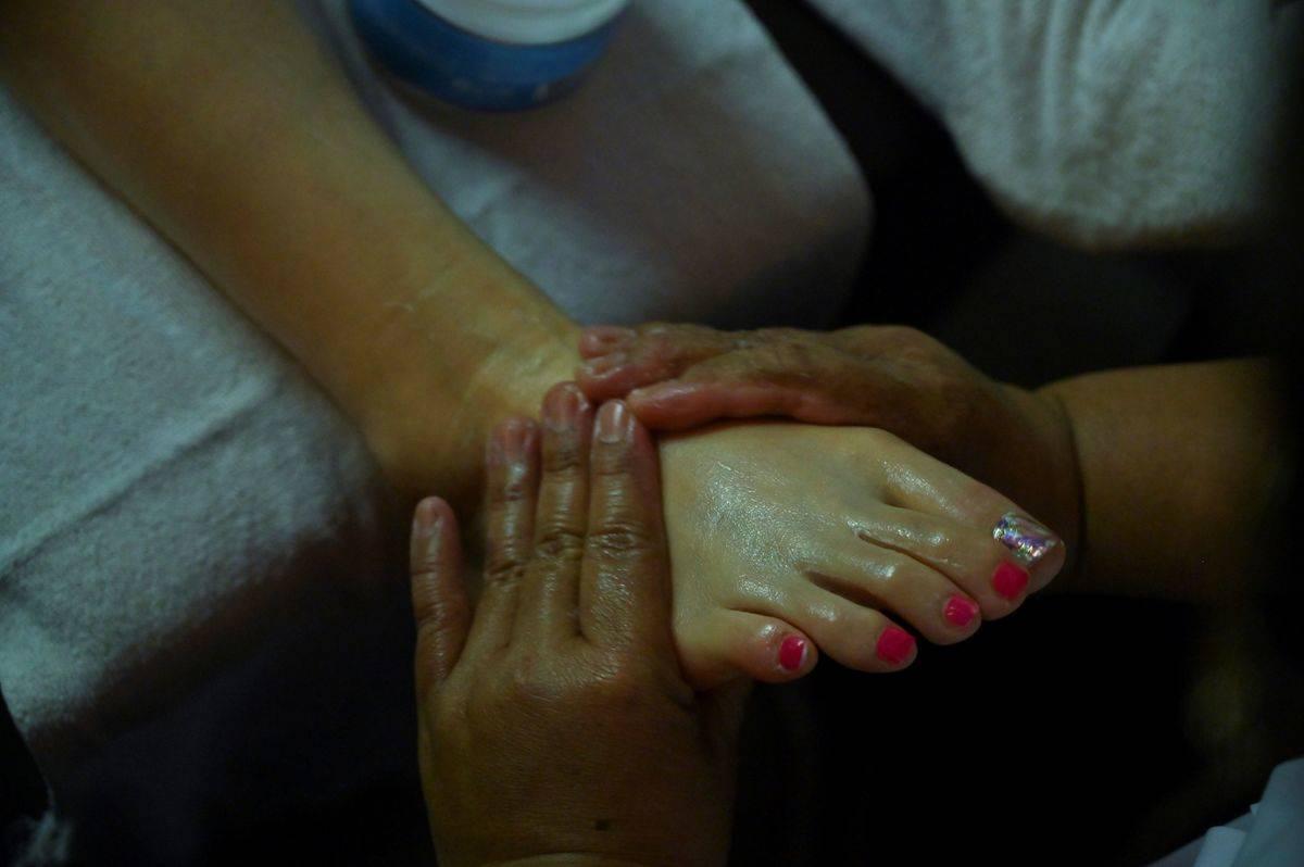 A woman receives a foot massage.