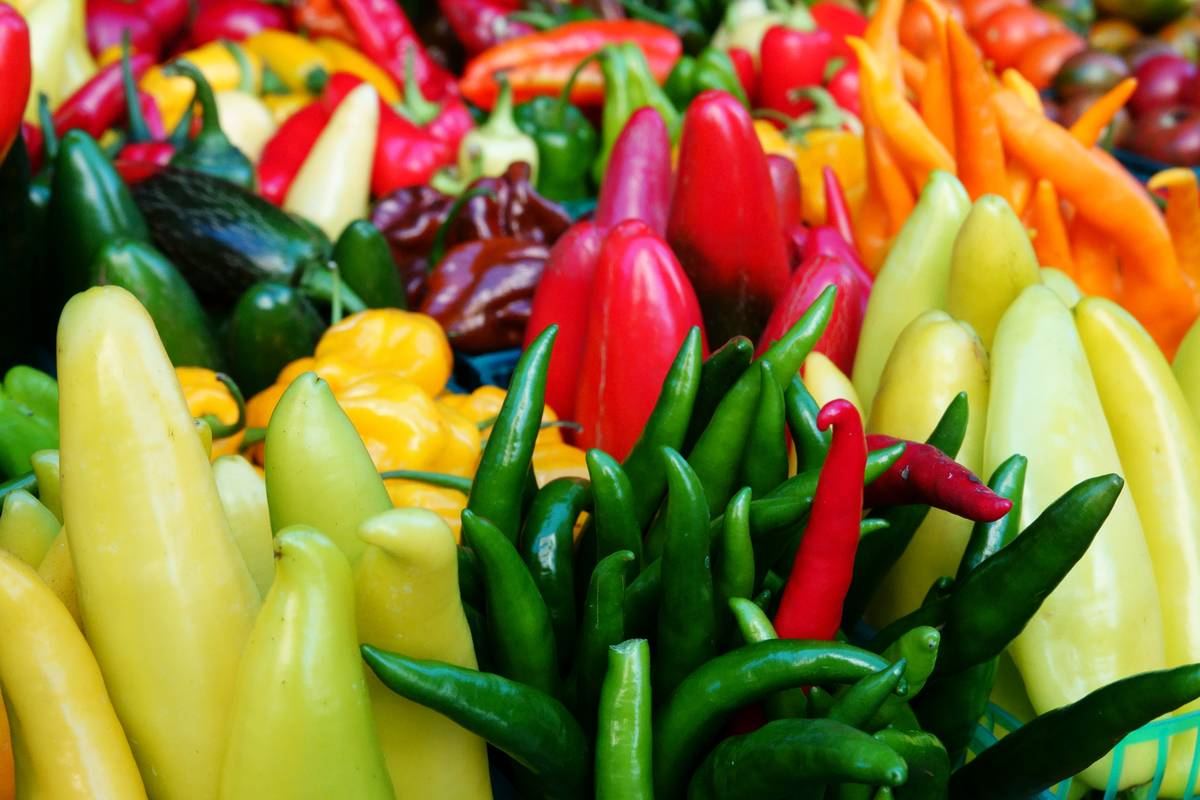Colorful hot peppers are on display at a market.
