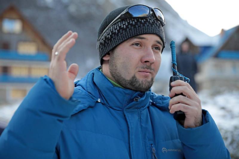 A man speaks through a portable radio.
