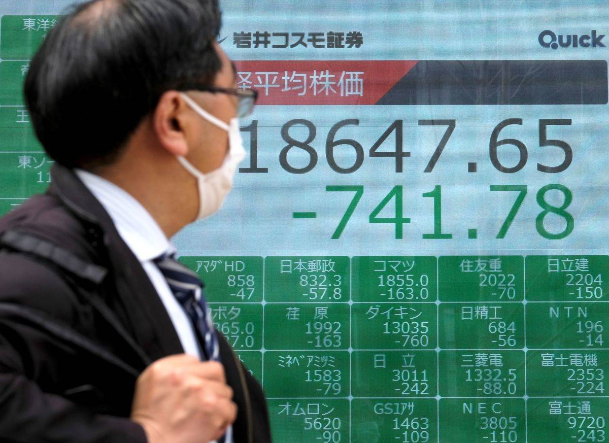 A man checks the stock market in Japan.
