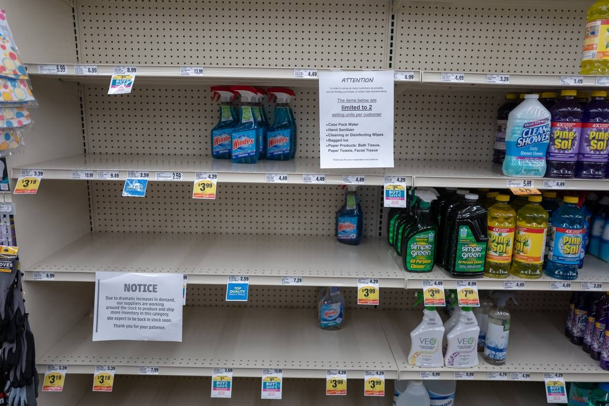 Shelves of cleaning supplies are nearly empty at a Lucky supermarket.