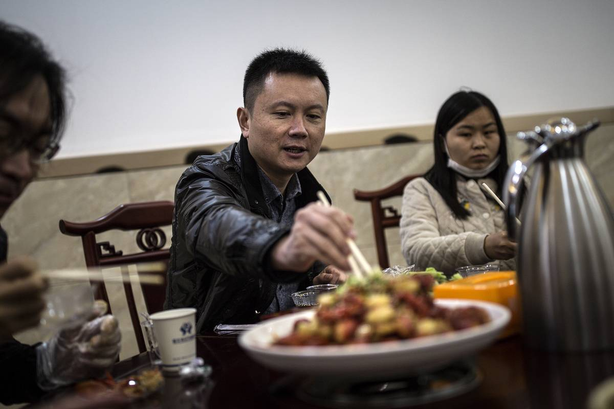 A family eats at a restaurant.