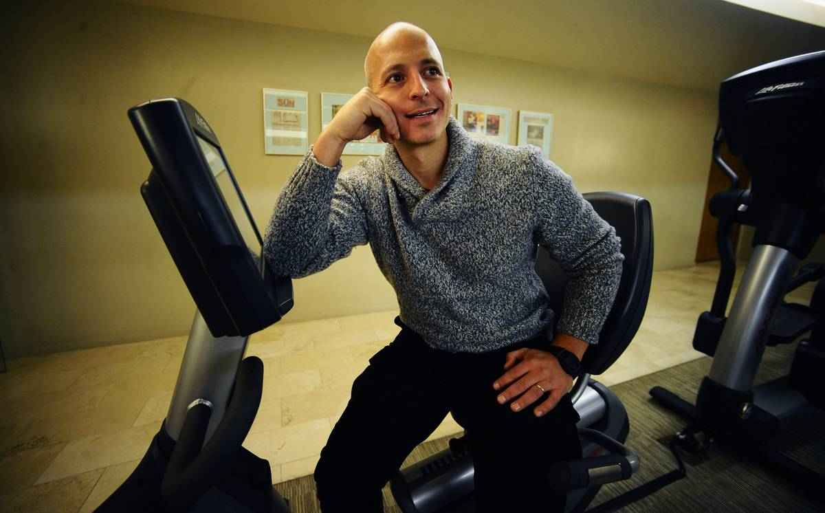 Harley Pasternak, author of Body Reset Diet, sits on an exercise bike.