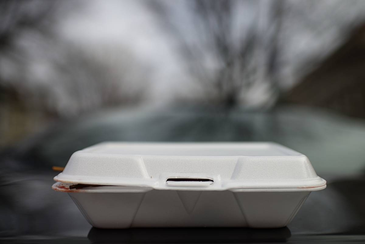 A styrofoam container holds leftovers from restaurants.