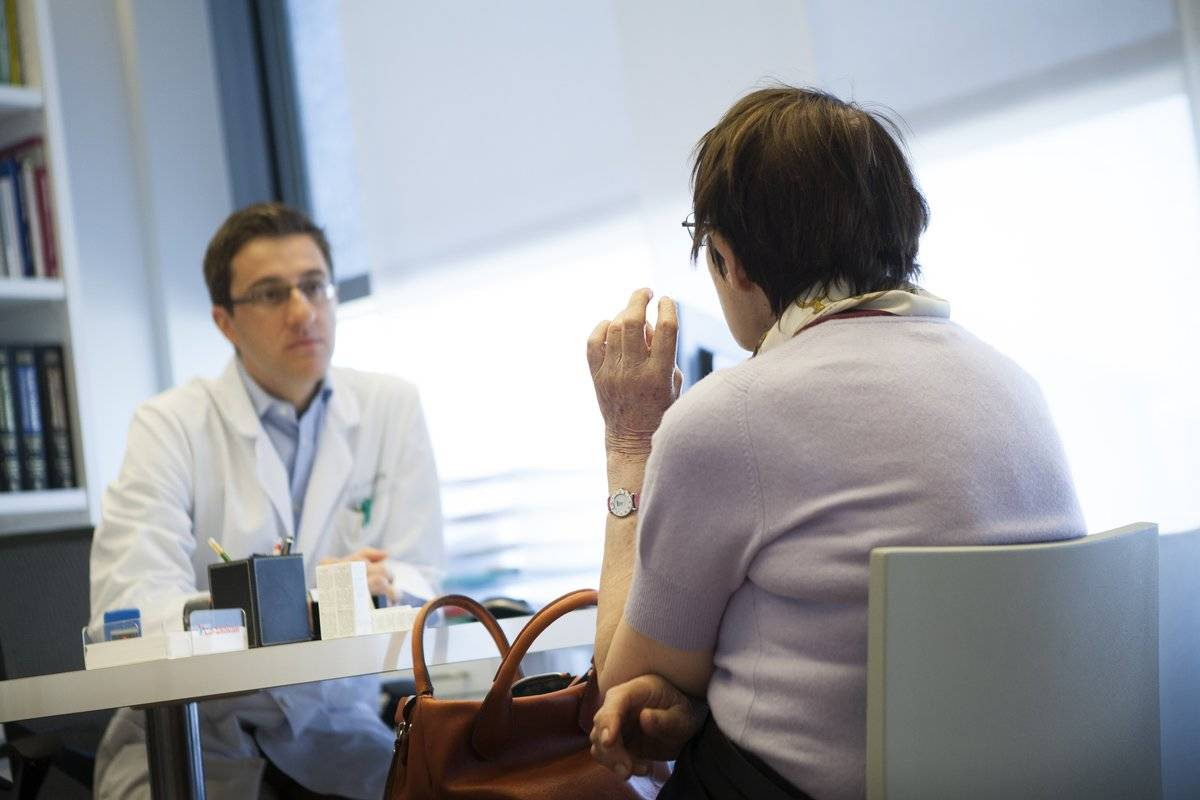 An elderly patient consults a doctor.