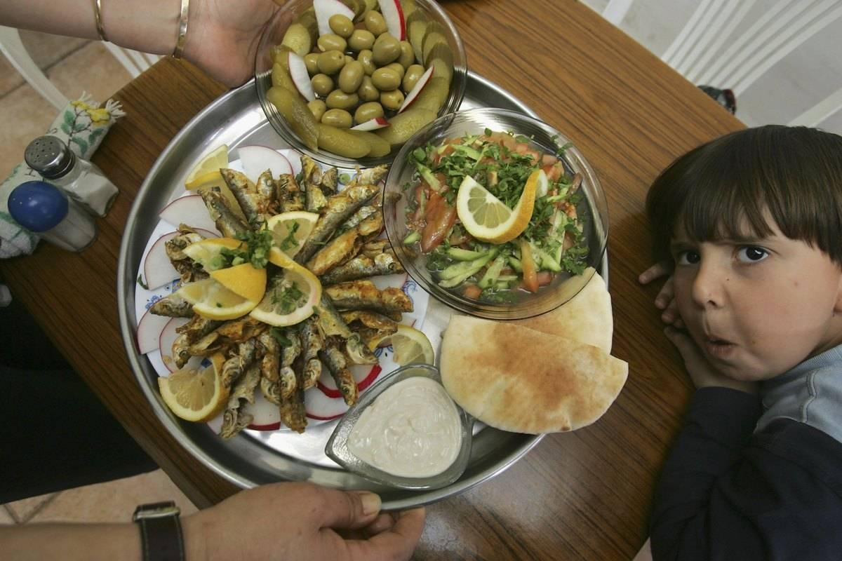 A platter features Mediterranean food.