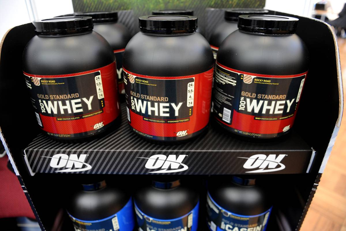 Canisters of whey protein are on display.