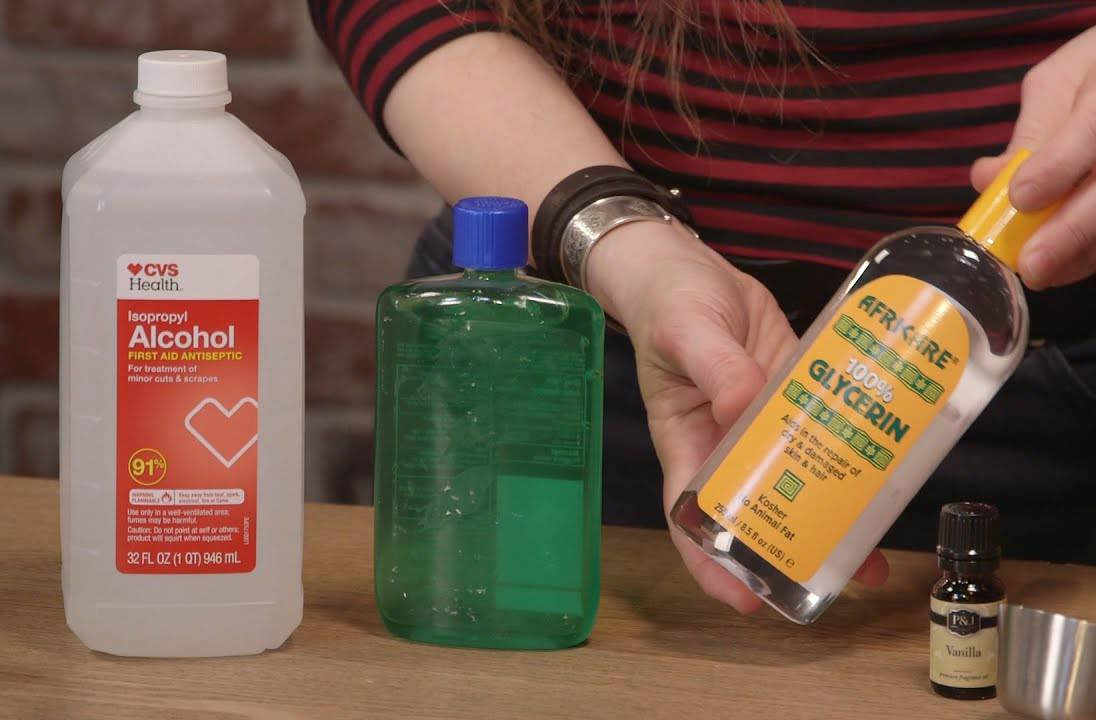 A YouTuber lays out supplies for a DIY hand sanitizer recipe.