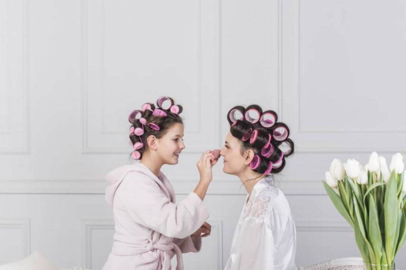 happy-daughter-putting-powder-mothers-face_23-2148070336-90224