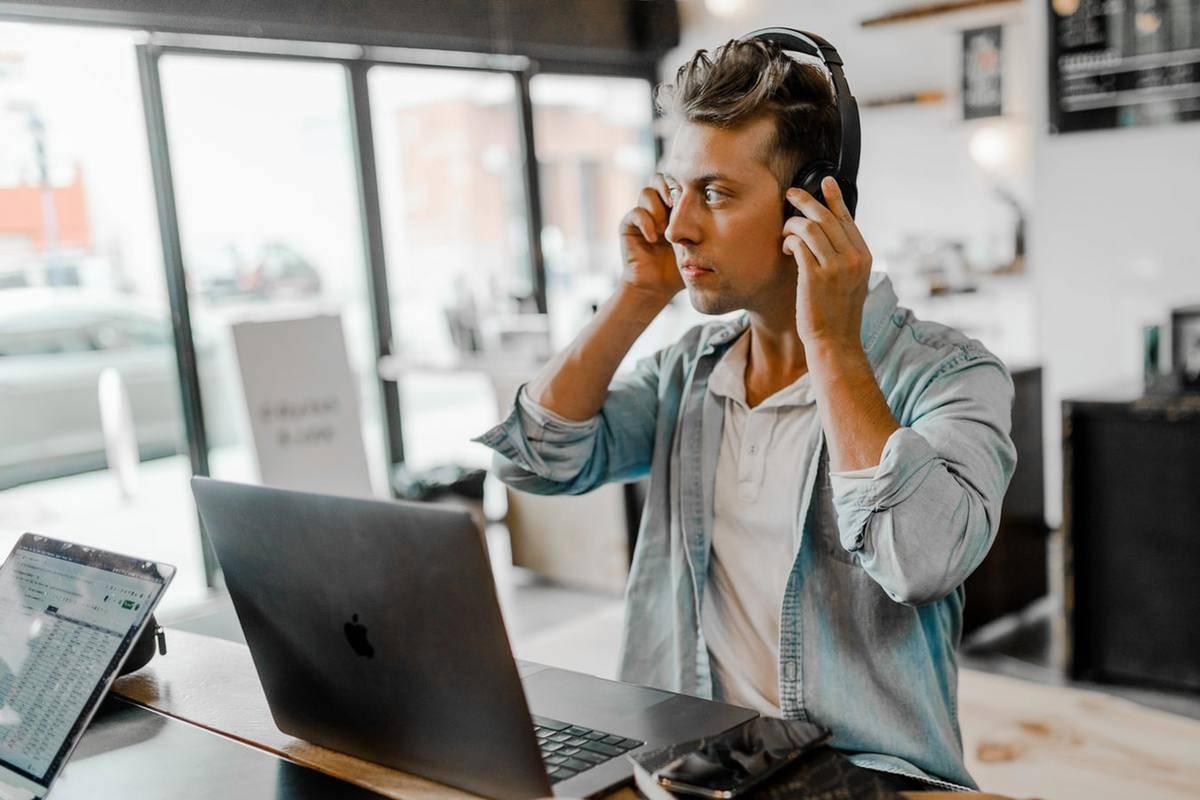 man listening to something