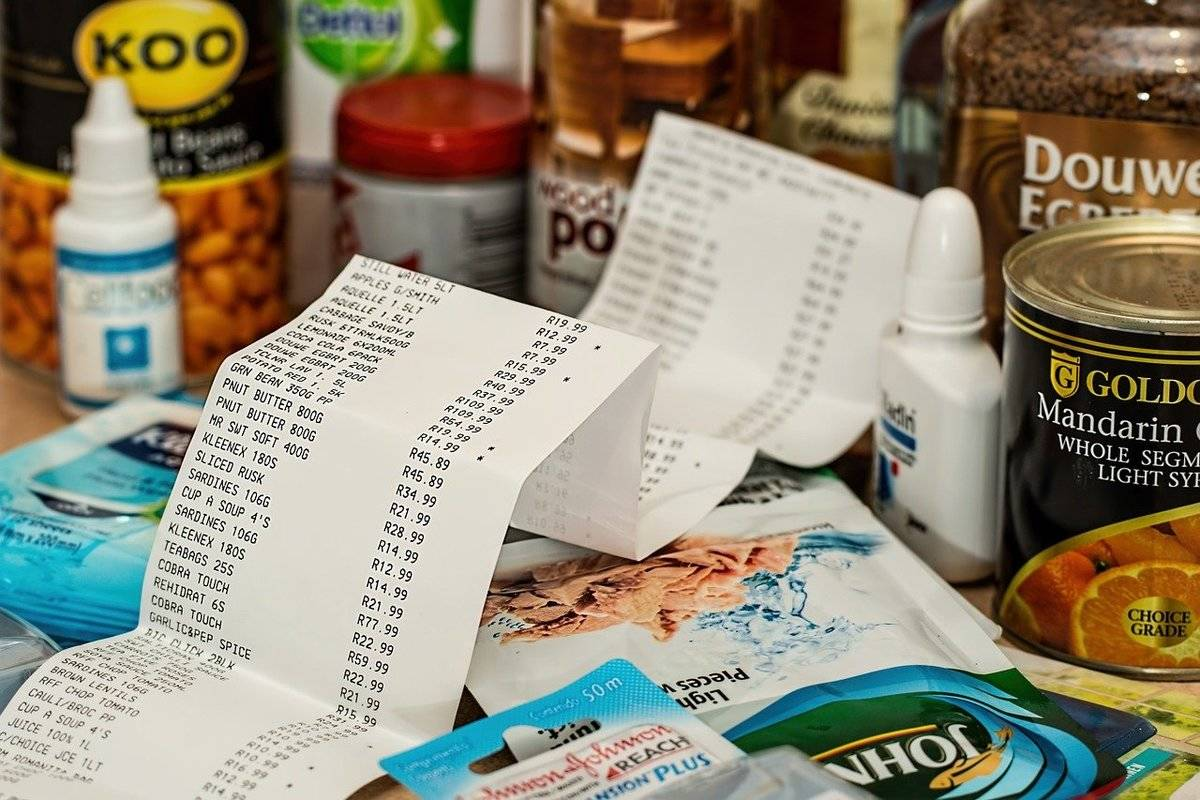 A long grocery store receipt lies on top of packaged food.