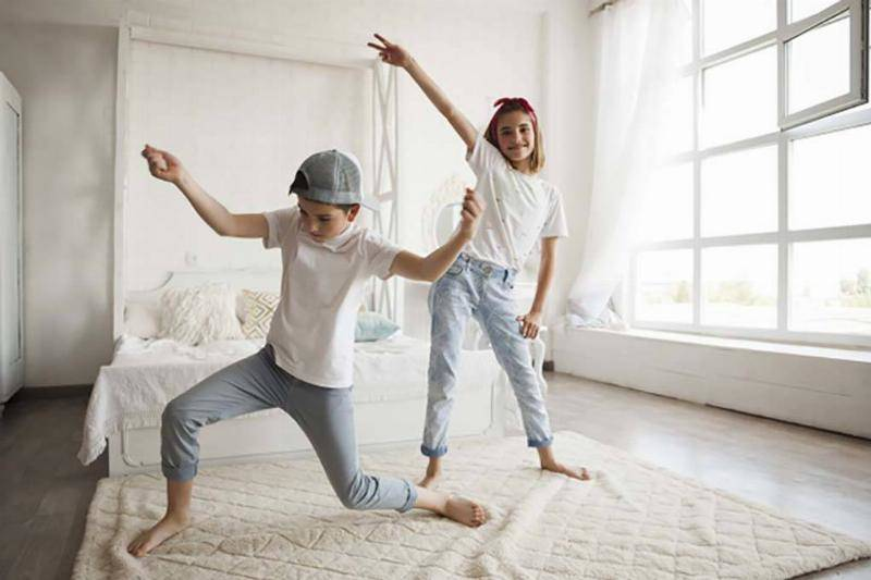 smiling-girl-dancing-with-her-little-brother-home_23-2148208040-86305