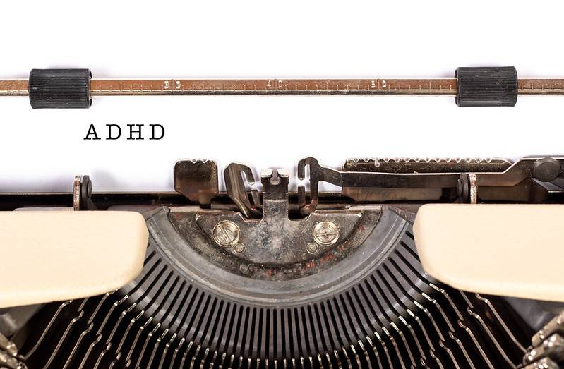 ADHD is typed on a typewriter.