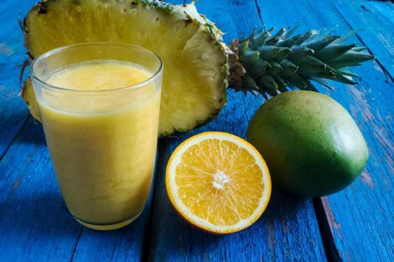 pinepple lemon and mango beside smoothie