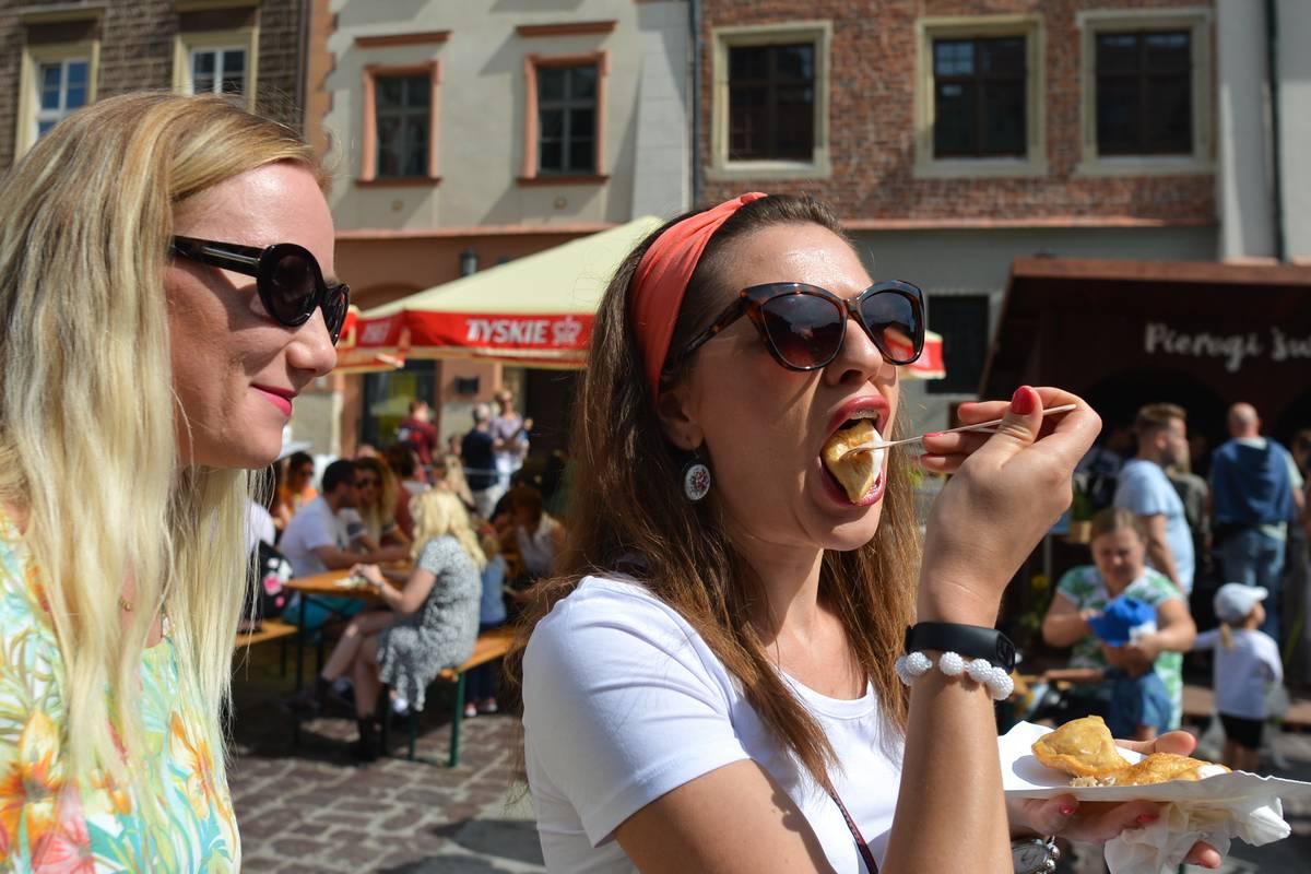 A lady enjoys eating Pierogi, a national dish of Poland.