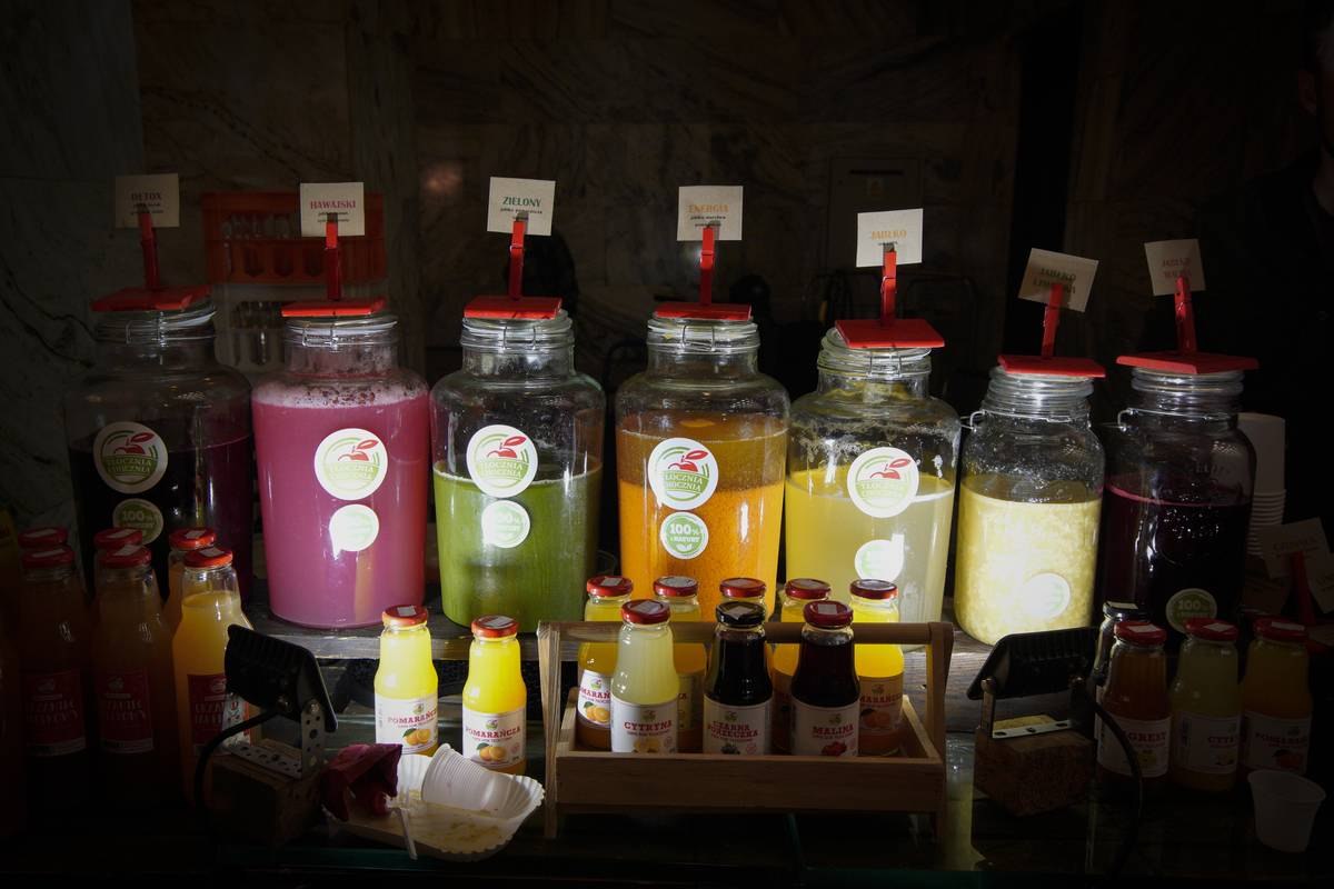 Fresh juices are available at a vegan food festival.