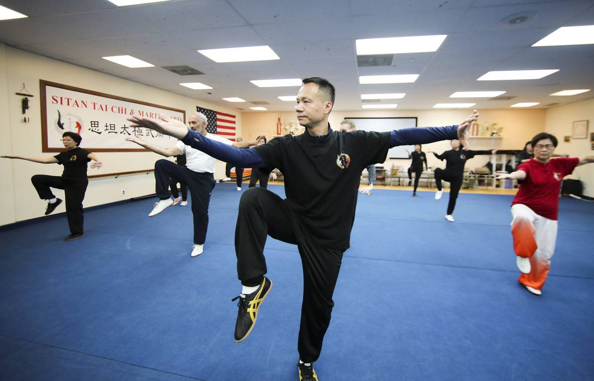 A class practices tai chi.
