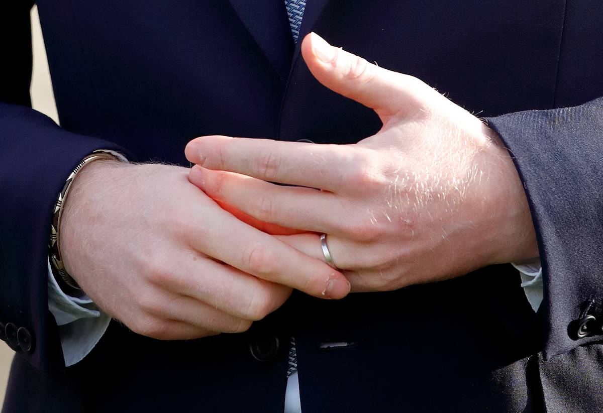 A man fidgets with his wedding ring.