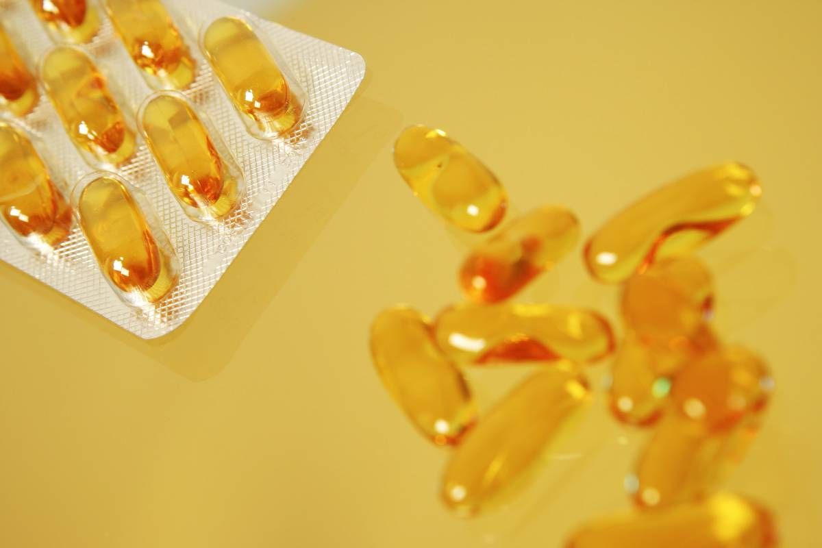 Fish oil supplements appear against a yellow background.