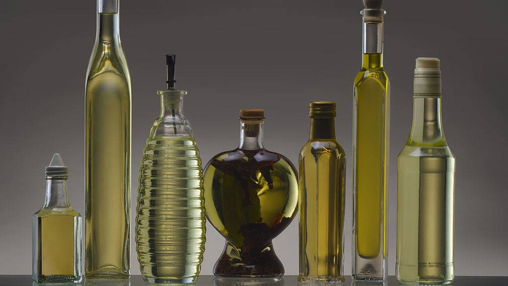 Still life featuring a collection of olive oil bottles, 2011