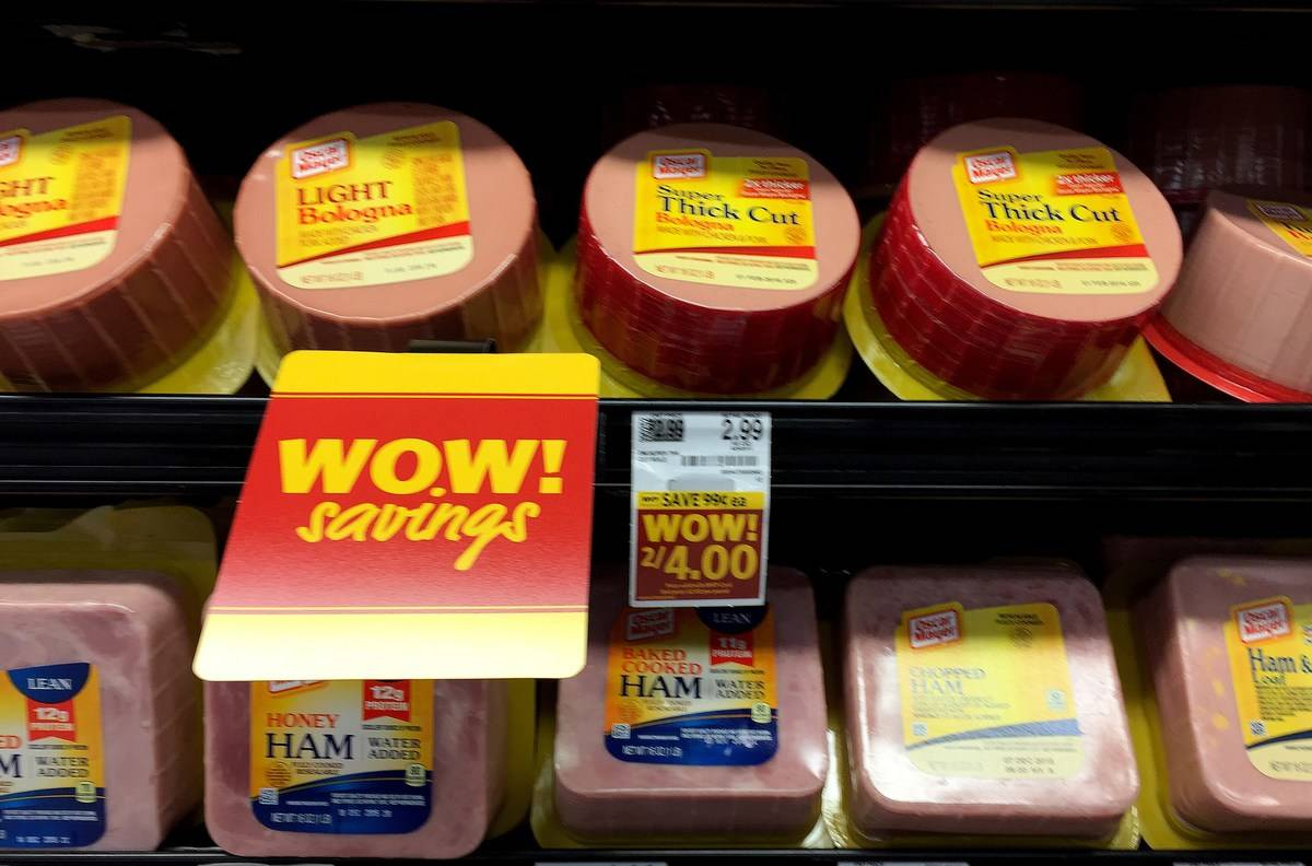 Ham and bologna lunch meats are displayed at a grocery store.