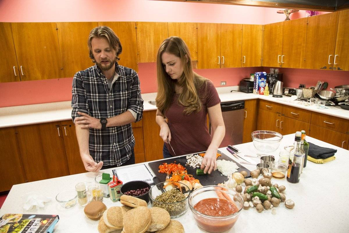 Thug Kitchen duo Matt Holloway and Michelle Davis prepare a meal together.