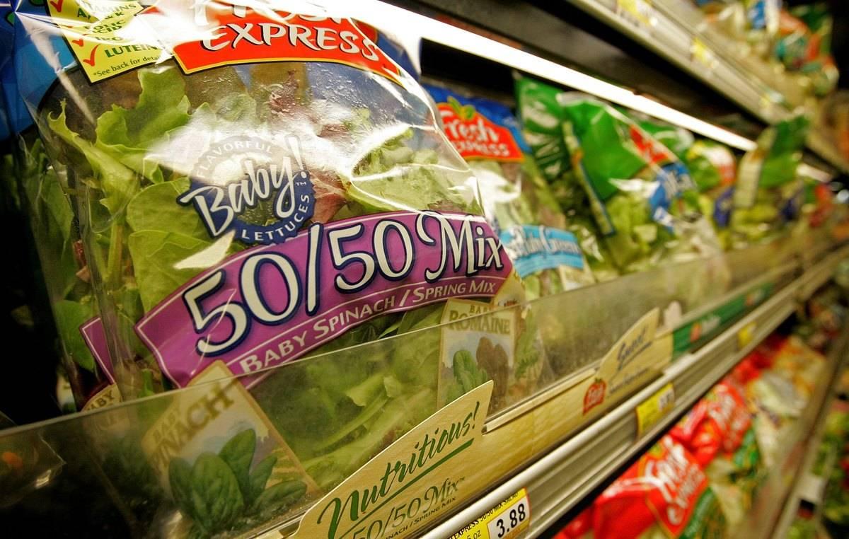 A close-up shows a bag of salad mix.