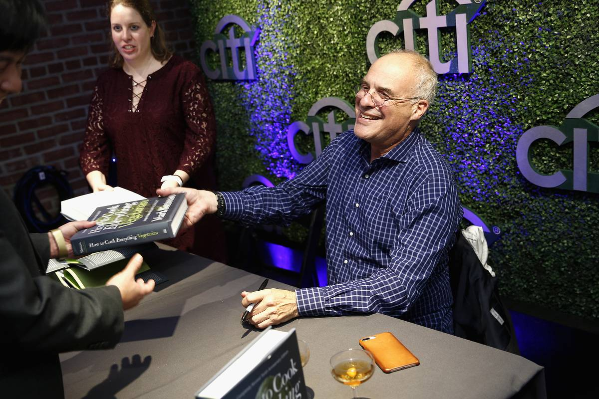 Mark Bittman signs copies of his vegetarian book for fans.