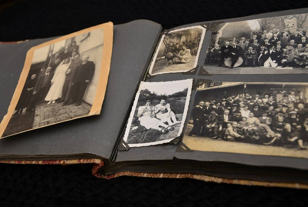 A photo album holds black-and-white photos.