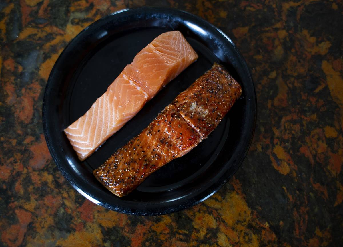 Raw salmon and hot smoked salmon are both on a plate.